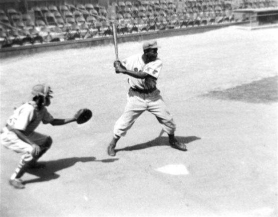 Jackie Robinson as a Kansas City Royal, batting.