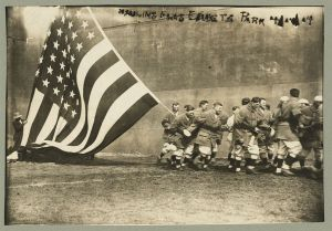 Hauling Flag at Ebbets Field 1914. Is that Casey Stengel in the front, second from left?