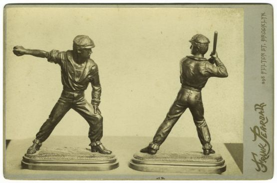 The eternal conflict in baseball, pitcher vs. striker. Muller & Deacon statuettes from 1868.