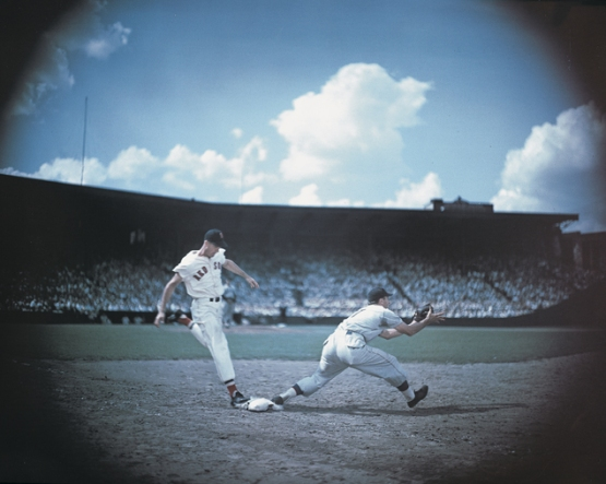 21.  Ted Williams beats the play at first, Fenway Park, ca. 1946; photographer unknown.
