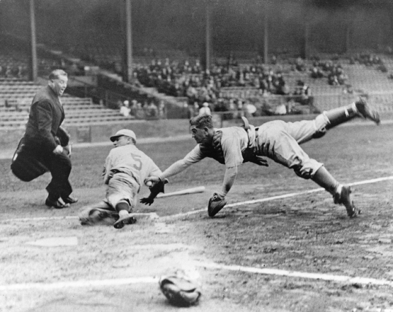 Mickey Cochrane tags out Phils' base runner Pinky Whitney. preseason exhibition, 1933