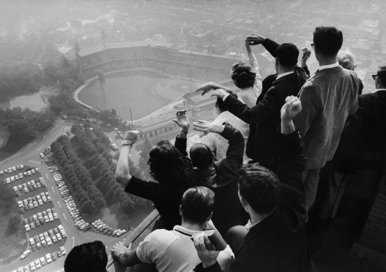 11.  University of Pittsburgh students cheer wildly from atop the Cathedral of Learning as they look down on Forbes Field, Game 7, 1960 World Series; George Silk for Life.