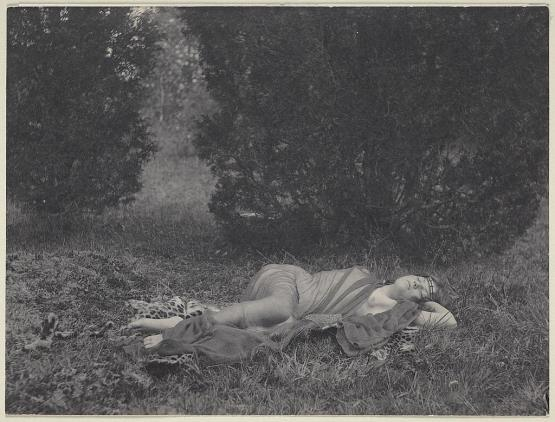 Girl in sheer drapery on leopard skin, in nature, reclining (Ethel Reed); photo by F. Holland Day